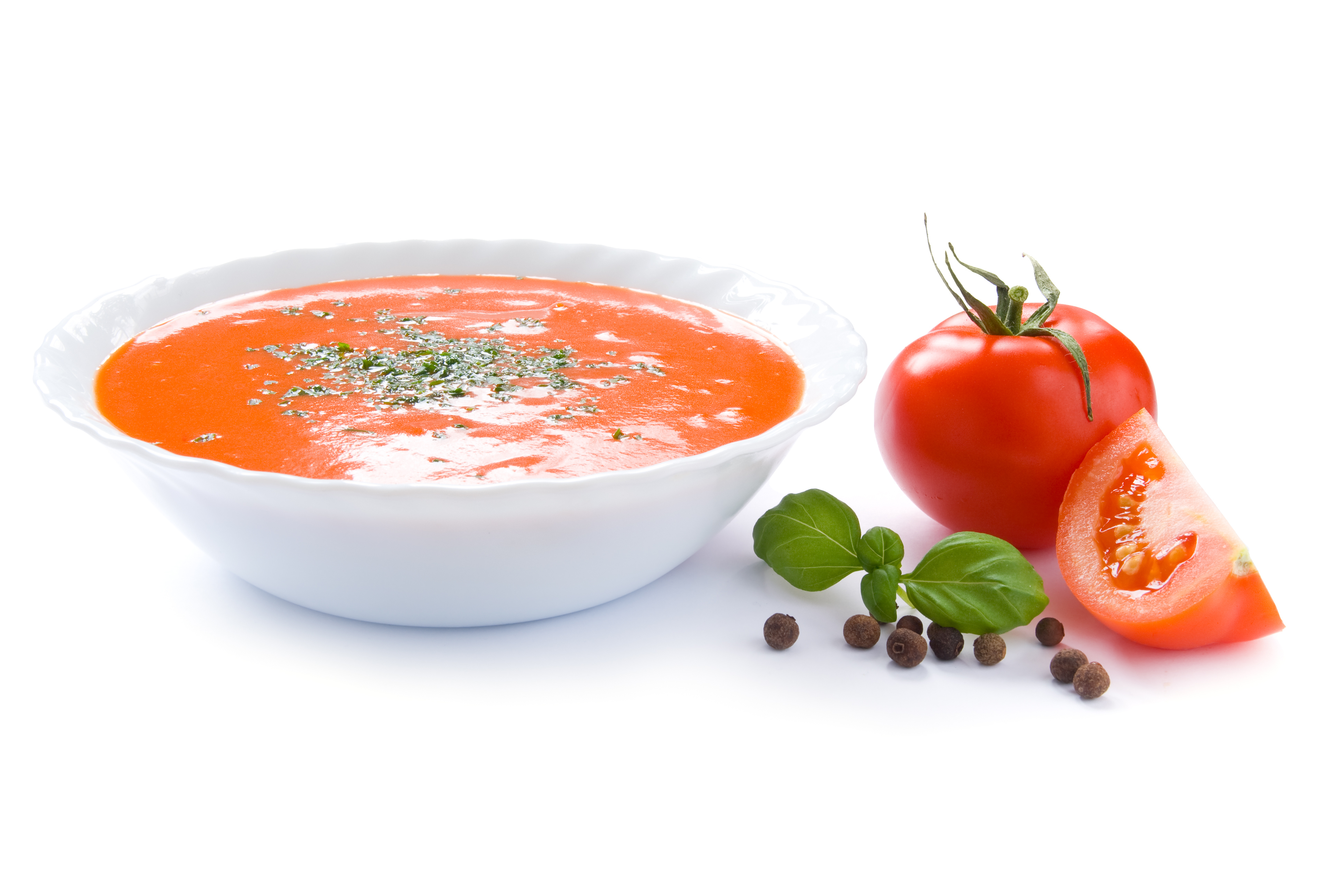 Tomato soup in a bowl isolated on a white background.